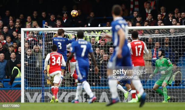 Chelsea's Spanish defender Marcos Alonso rises above Arsenal's Spanish defender Hector Bellerin to score the opening goal during the English Premier...