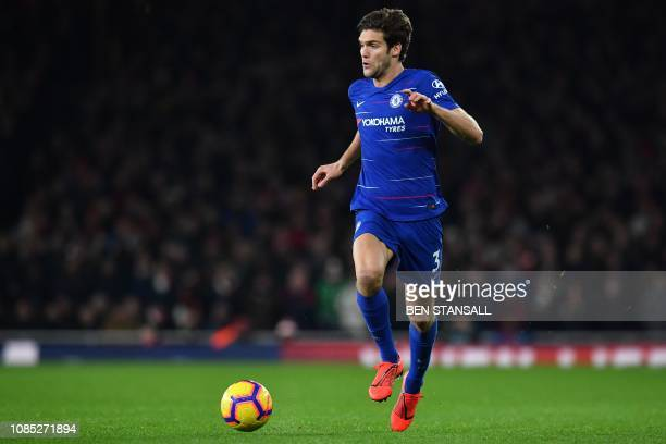 Chelsea's Spanish defender Marcos Alonso runs with the ball during the English Premier League football match between Arsenal and Cheslea at the...