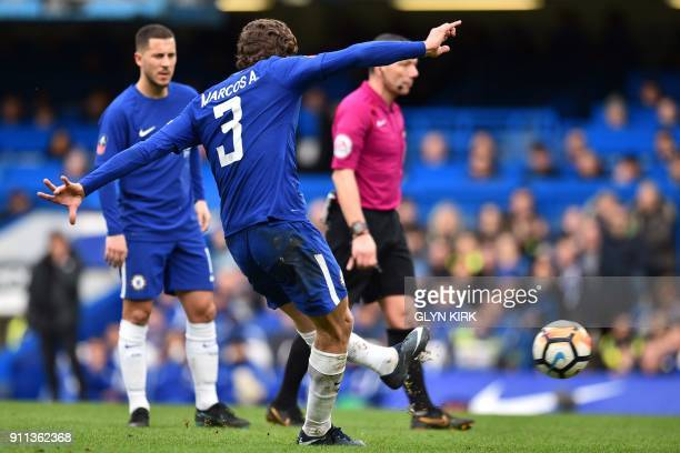 Chelsea's Spanish defender Marcos Alonso scores their third goal from this freekick during the English FA Cup fourth round football match between...