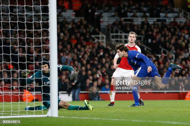 Chelsea's Spanish defender Marcos Alonso shoots and scores their second goal during the English Premier League football match between Arsenal and...