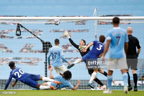 Chelsea's Spanish defender Marcos Alonso shoots over Manchester City's Brazilian goalkeeper Ederson to score their late winner during the English...