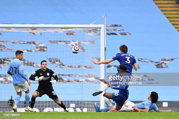 Chelsea's Spanish defender Marcos Alonso shoots to score their late winner during the English Premier League football match between Manchester City...