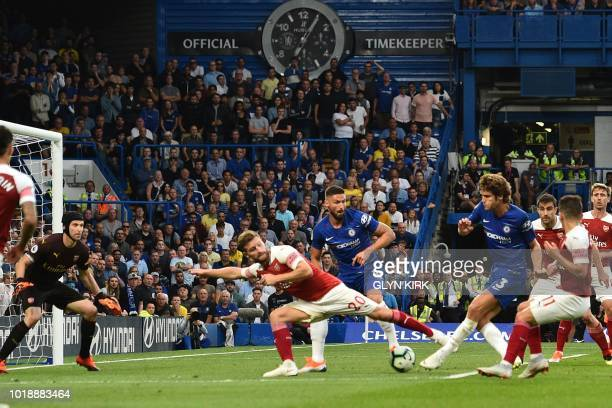 Chelsea's Spanish defender Marcos Alonso shoots to score their third goal during the English Premier League football match between Chelsea and...