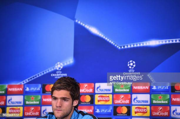Chelsea's Spanish defender Marcos Alonso takes part in a press conference after training at Chelsea's Cobham training facility in Stoke D'Abernon...