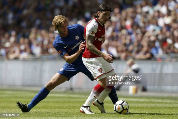 Chelsea's Spanish defender Marcos Alonso vies with Arsenal's Spanish defender Hector Bellerin during the English FA Community Shield football match...