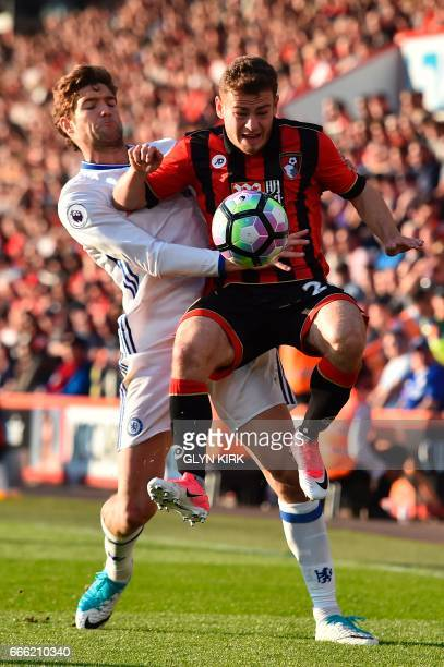 Chelsea's Spanish defender Marcos Alonso vies with Bournemouth's Scottish midfielder Ryan Fraser during the English Premier League football match...