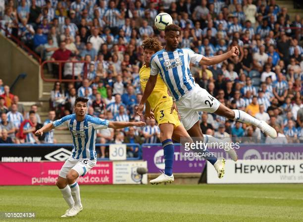 Chelsea's Spanish defender Marcos Alonso vies with Huddersfield Town's Beninese striker Steve Mounie during the English Premier League football match...