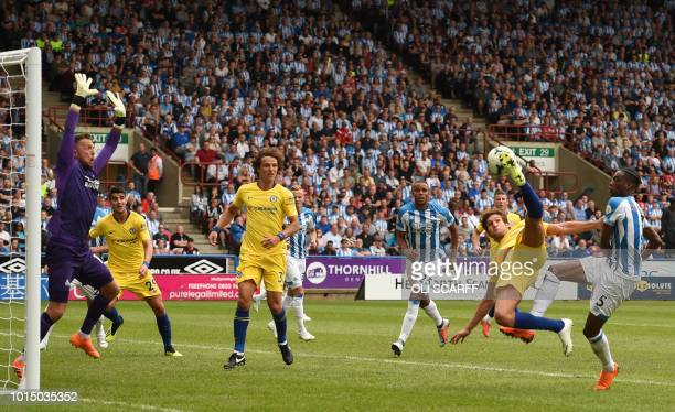 Chelsea's Spanish defender Marcos Alonso vies with Huddersfield Town's Swissborn Dutch defender Terence Kongolo as Huddersfield Town's English...