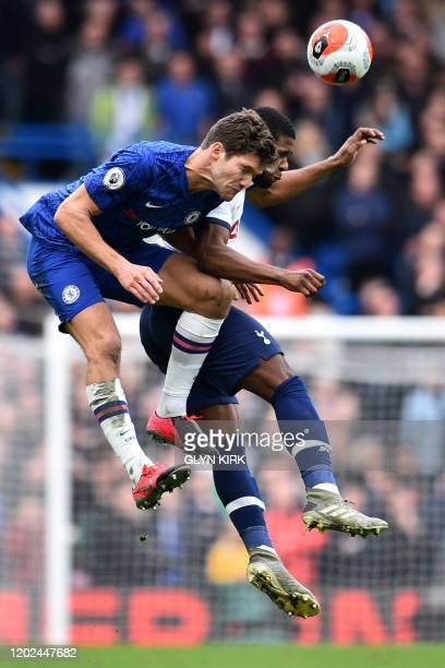 Chelsea's Spanish defender Marcos Alonso vies with Tottenham Hotspur's English midfielder Japhet Tanganga during the English Premier League football...