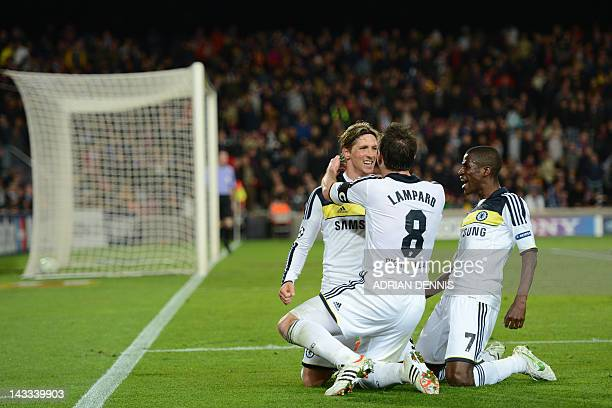 Chelsea's Spanish forward Fernando Torres celebrates with teammates midfielder Frank Lampard and Brazilian midfielder Ramires after scoring during...