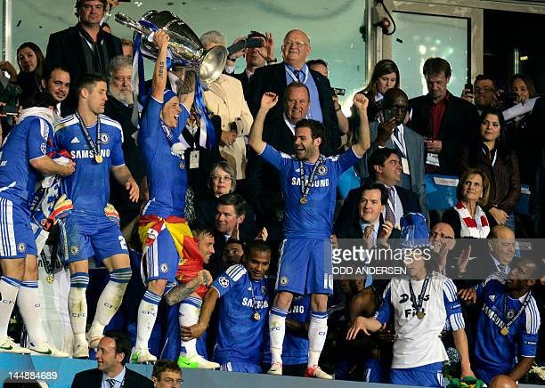 Chelsea's Spanish forward Fernando Torres holds the trophy after winning the UEFA Champions League final football match between FC Bayern Muenchen...