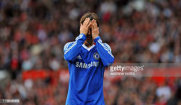 Chelsea's Spanish forward Fernando Torres reacts during the English Premier League football match between Manchester United and Chelsea at Old...