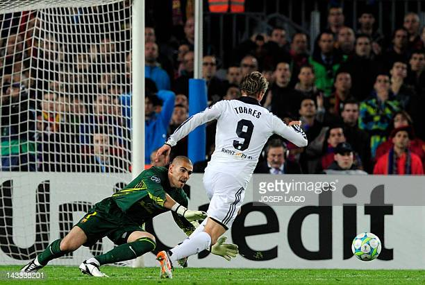 Chelsea's Spanish forward Fernando Torres rounds Barcelona's goalkeeper Victor Valdes to score during the UEFA Champions League second leg semifinal...