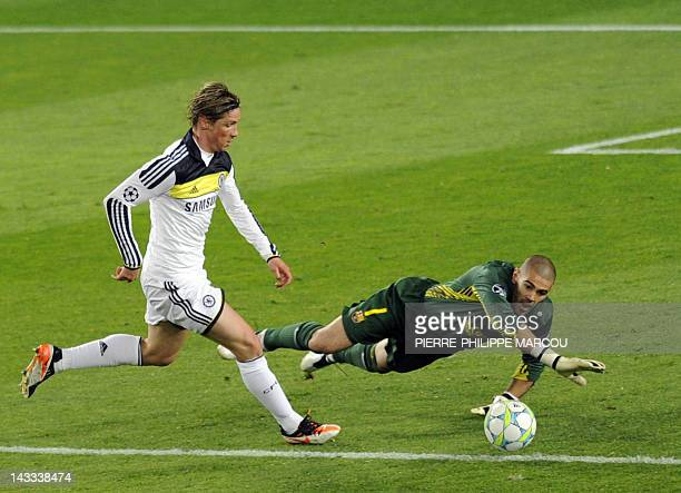 Chelsea's Spanish forward Fernando Torres runs past Barcelona's goalkeeper Victor Valdes to score and win the match during the UEFA Champions League...