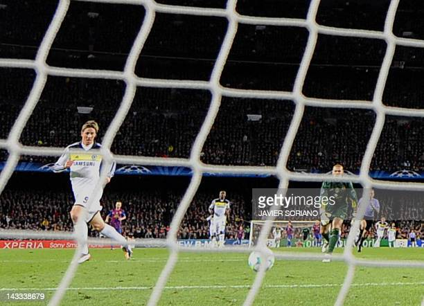 Chelsea's Spanish forward Fernando Torres scores against Barcelona's goalkeeper Victor Valdes during the UEFA Champions League second leg semifinal...