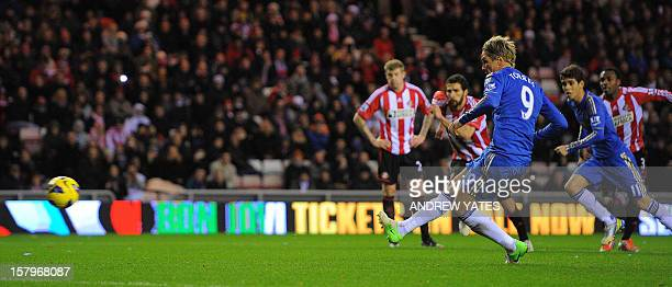 Chelsea's Spanish forward Fernando Torres scores from the penalty spot for his second goal against Sunderland during the English Premier League...