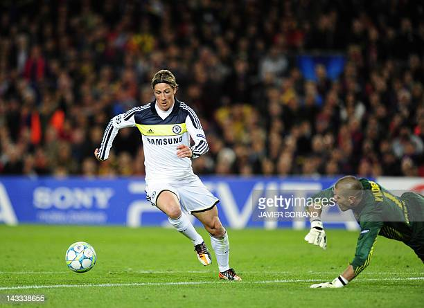 Chelsea's Spanish forward Fernando Torres vies for the ball with Barcelona's goalkeeper Victor Valdes before scoring during the UEFA Champions League...