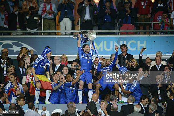Chelsea's Spanish forward Juan Mata holds the trophy after the UEFA Champions League final football match between FC Bayern Muenchen and Chelsea FC...