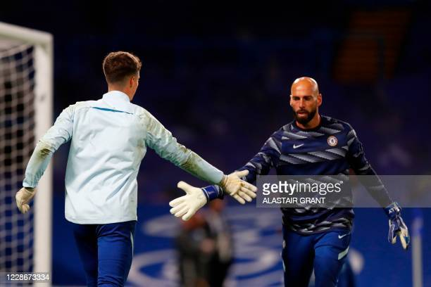Chelsea's Spanish goalkeeper Kepa Arrizabalaga and Chelsea's Argentinian goalkeeper Willy Caballero taps hands prior to the English League Cup third...