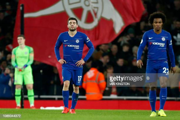 Chelsea's Spanish goalkeeper Kepa Arrizabalaga Chelsea's Croatian midfielder Mateo Kovacic and Chelsea's Brazilian midfielder Willian react after...