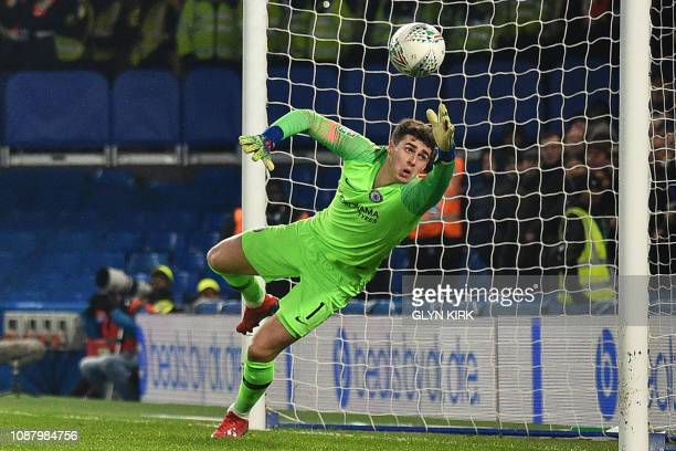 Chelsea's Spanish goalkeeper Kepa Arrizabalaga dives but cannot prevent a header from Tottenham Hotspur's Spanish striker Fernando Llorente making...