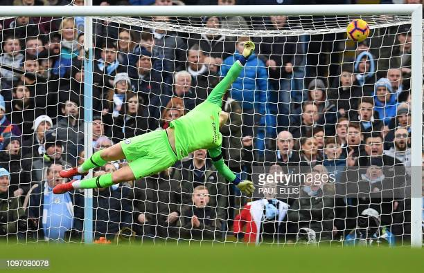 Chelsea's Spanish goalkeeper Kepa Arrizabalaga fails to save the first goal from Manchester City's Argentinian striker Sergio Aguero during the...