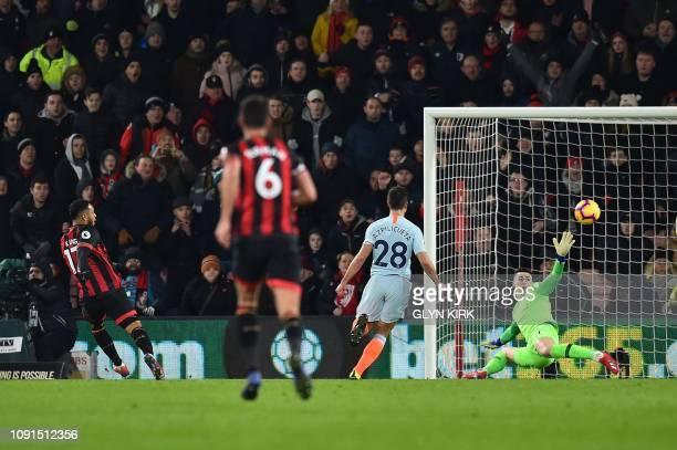 Chelsea's Spanish goalkeeper Kepa Arrizabalaga fails to stop the ball as Bournemouth's Norwegian striker Joshua King scores his team's third goal...