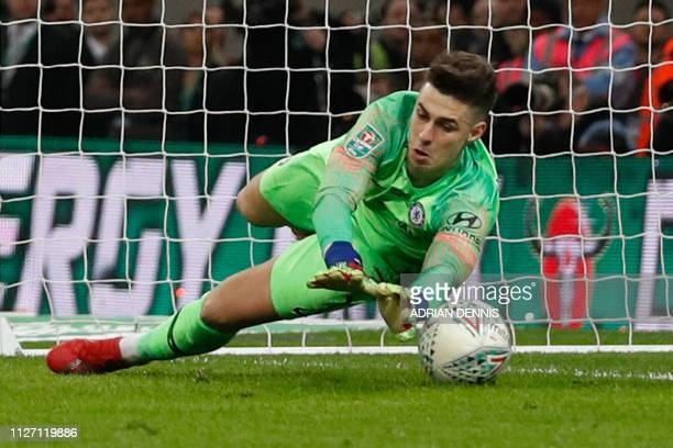 Chelsea's Spanish goalkeeper Kepa Arrizabalaga fails to stop the ball from Manchester City's Argentinian striker Sergio Aguero in the penalty shoot...