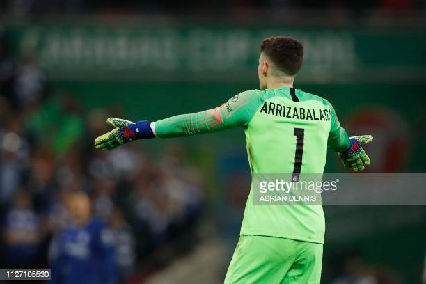 Chelsea's Spanish goalkeeper Kepa Arrizabalaga gestures toward the bench after his number came up for substitution and didn't leave the pitch during...