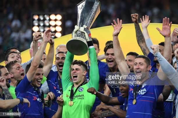 Chelsea's Spanish goalkeeper Kepa Arrizabalaga holds the trophy as he celebrates with teammates after winning the UEFA Europa League final football...