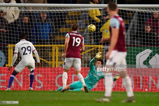 Chelsea's Spanish goalkeeper Kepa Arrizabalaga makes a save during the English Premier League football match between Burnley and Chelsea at Turf Moor...