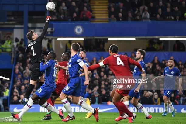 Chelsea's Spanish goalkeeper Kepa Arrizabalaga punches the ball clear has he makes a save during the English FA Cup fifth round football match...