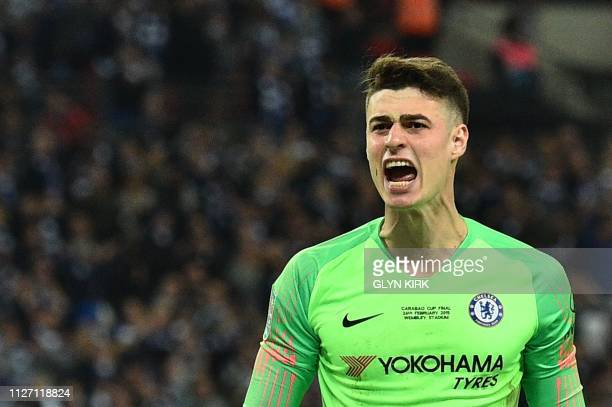 Chelsea's Spanish goalkeeper Kepa Arrizabalaga reacts after saving the penalty of Manchester City's German midfielder Leroy Sane in the penalty...