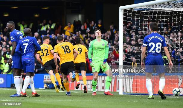 Chelsea's Spanish goalkeeper Kepa Arrizabalaga reacts after Wolverhampton Wanderers' Mexican striker Raul Jimenez scored the opening goal during the...
