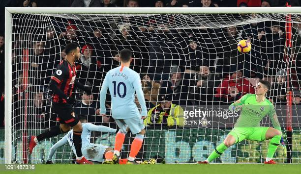 Chelsea's Spanish goalkeeper Kepa Arrizabalaga reacts as Bournemouth's Norwegian striker Joshua King celebrates scoring the opening goal during the...