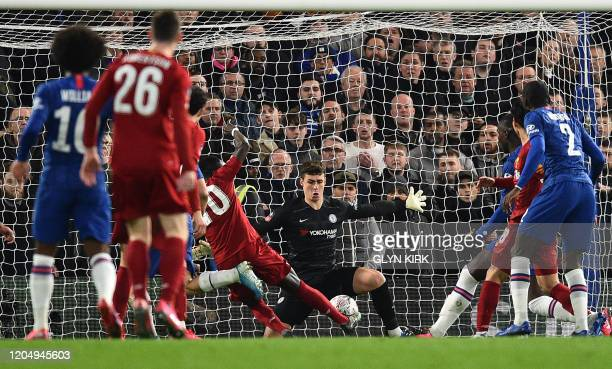Chelsea's Spanish goalkeeper Kepa Arrizabalaga saves a shot from Liverpool's Senegalese striker Sadio Mane during the English FA Cup fifth round...