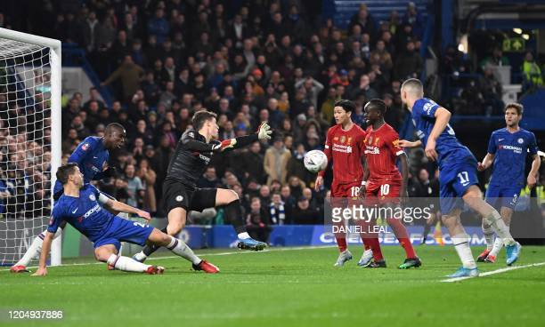 Chelsea's Spanish goalkeeper Kepa Arrizabalaga saves the ball during the English FA Cup fifth round football match between Chelsea and Liverpool at...