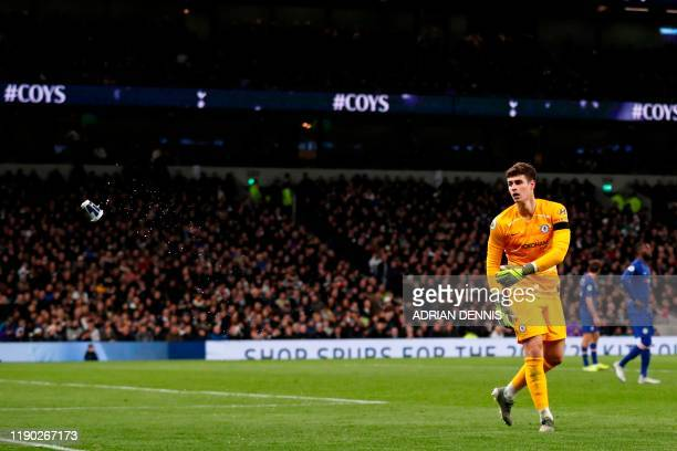 Chelsea's Spanish goalkeeper Kepa Arrizabalaga throws a drink container off the playing surface during the English Premier League football match...