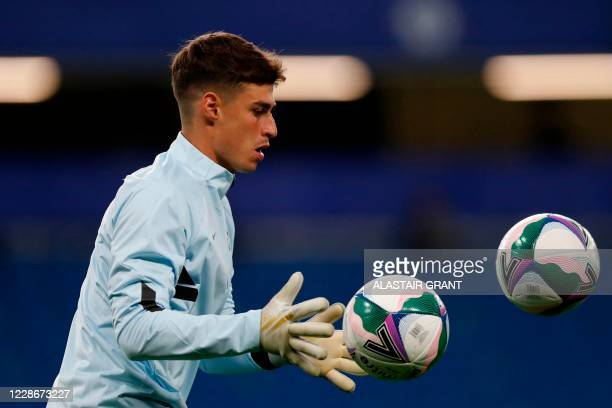 Chelsea's Spanish goalkeeper Kepa Arrizabalaga warms up prior to the English League Cup third round football match between Chelsea and Barnsley at...