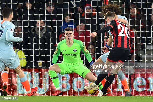 Chelsea's Spanish goalkeeper Kepa Arrizabalaga watches as Bournemouth's Englishborn Welsh midfielder David Brooks scores his team's second goal...
