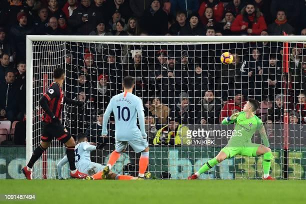 Chelsea's Spanish goalkeeper Kepa Arrizabalaga watches the ball as Bournemouth's Norwegian striker Joshua King scores the opening goal during the...