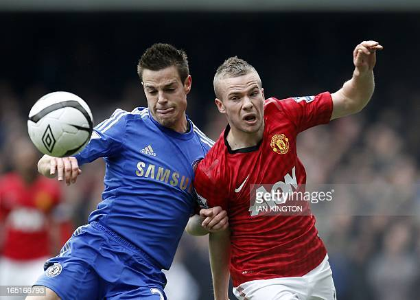 Chelsea's Spanish midfielder Cesar Azpilicueta vies with Manchester United's English midfielder Tom Cleverley during the FA Cup quarter final replay...