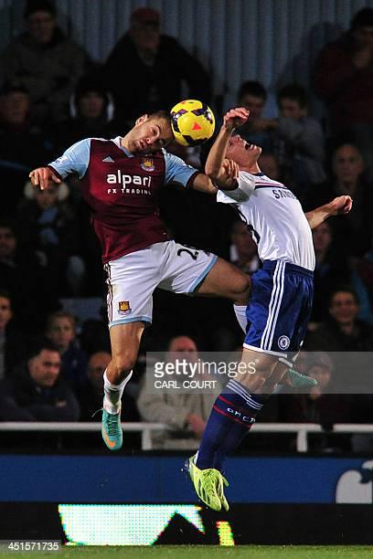 Chelsea's Spanish midfielder Cesar Azpilicueta vies with West Ham United's English striker Joe Cole during the English Premier League football match...