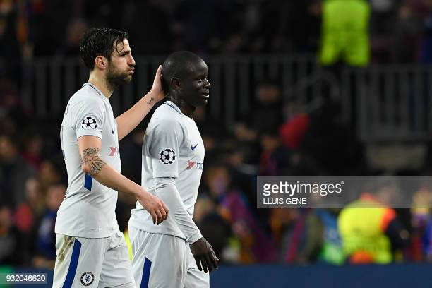 Chelsea's Spanish midfielder Cesc Fabregas and Chelsea's French midfielder N'Golo Kante react at the end of the UEFA Champions League round of...
