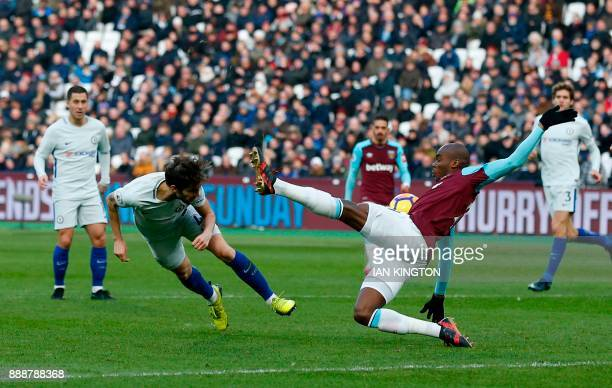Chelsea's Spanish midfielder Cesc Fabregas attempts a header at goal during the English Premier League football match between West Ham United and...