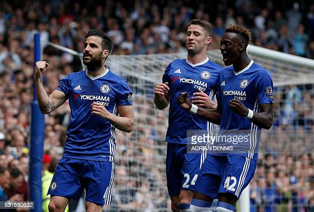 Chelsea's Spanish midfielder Cesc Fabregas celebrates after scoring a penalty during the English Premier League football match between Chelsea and...