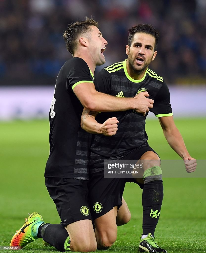 Chelsea's Spanish midfielder Cesc Fabregas (R) celebrates after scoring their fourth goal with teammate Chelsea's English defender Gary Cahill (L) during the English League Cup third round football match between Leicester City and Chelsea at King Power Stadium in Leicester, central England on September 20, 2016. Chelsea won the game 4-2 after extra time. / AFP / ANTHONY DEVLIN / RESTRICTED TO EDITORIAL USE. No use with unauthorized audio, video, data, fixture lists, club/league logos or 'live' services. Online in-match use limited to 75 images, no video emulation. No use in betting, games or single club/league/player publications. /