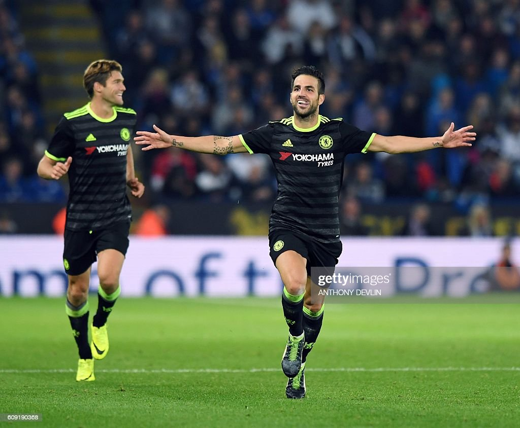 Chelsea's Spanish midfielder Cesc Fabregas (R) celebrates scoring their fourth goal during extra-time in the English League Cup third round football match between Leicester City and Chelsea at King Power Stadium in Leicester, central England on September 20, 2016. / AFP / ANTHONY DEVLIN / RESTRICTED TO EDITORIAL USE. No use with unauthorized audio, video, data, fixture lists, club/league logos or 'live' services. Online in-match use limited to 75 images, no video emulation. No use in betting, games or single club/league/player publications. /