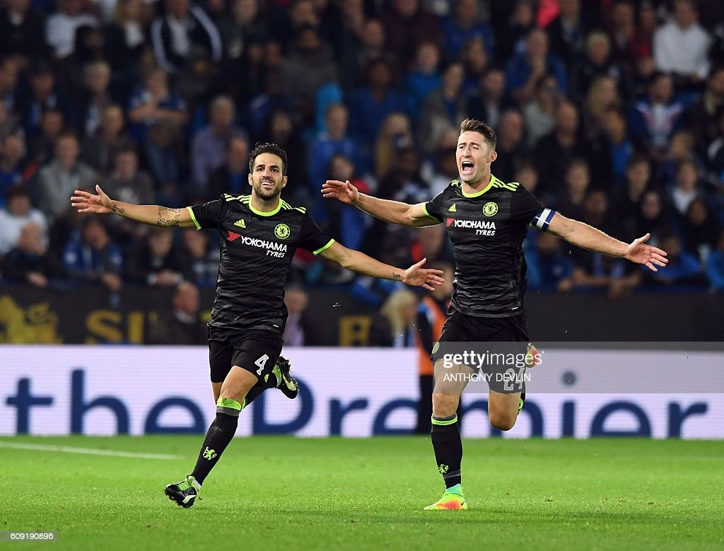 Chelsea's Spanish midfielder Cesc Fabregas (L) celebrates scoring their fourth goal with teammate Gary Cahill (R) during extra-time in the English League Cup third round football match between Leicester City and Chelsea at King Power Stadium in Leicester, central England on September 20, 2016. / AFP / ANTHONY DEVLIN / RESTRICTED TO EDITORIAL USE. No use with unauthorized audio, video, data, fixture lists, club/league logos or 'live' services. Online in-match use limited to 75 images, no video emulation. No use in betting, games or single club/league/player publications. /