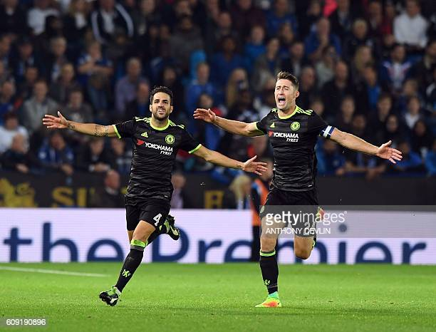 Chelsea's Spanish midfielder Cesc Fabregas celebrates scoring their fourth goal with teammate Gary Cahill during extratime in the English League Cup...
